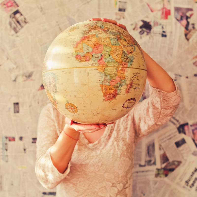 image of a person holding a globe